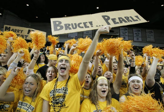 UW Milwaukee's students celebrate as the Panthers move towards a win against the Detroit Titans at the US Cellular Arena on March 8, 2005.