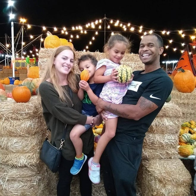Shannon Lilly, left, and Devin Harris are pictured with their two children. The family received an anonymous racist letter in the mail telling them to move.