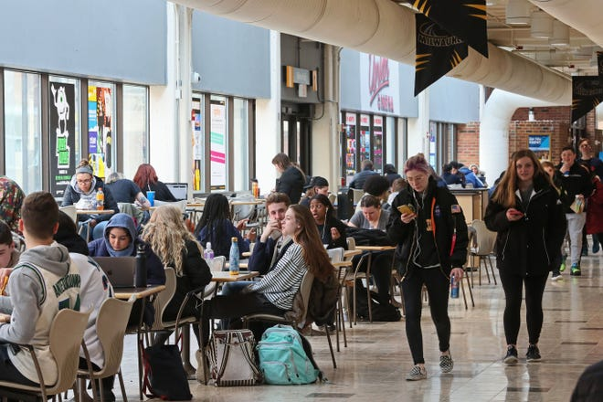 Students socialize, study and eat lunch in the student union at the University of Wisconsin-Milwaukee before the pandemic. A key Republican legislator is calling for further reorganization of the UW System as a way to streamline costs.