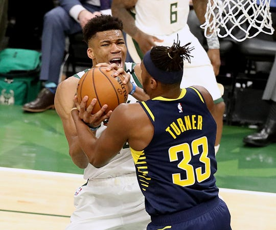 Bucks forward Giannis Antetokounmpo and Pacers center Myles Turner get a jump ball call.