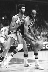 Milwaukee Bucks star Lew Alcindor (left) defends against the San Francisco Warriors' Nate Thurmond  during an NBA playoff game in Madison on March 31, 1971.