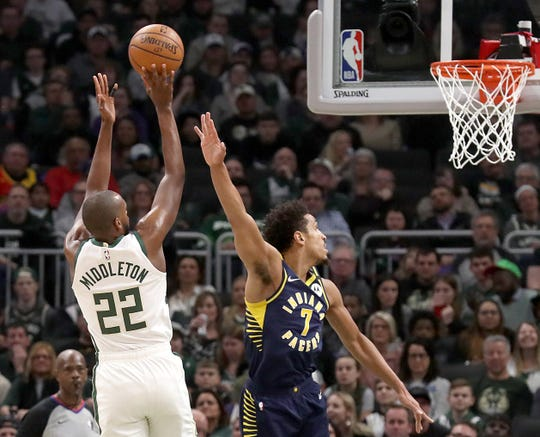 The Bucks will have a first-round pick in the draft, having acquired the Indiana Pacers' after trading Malcolm Brogdon, right.