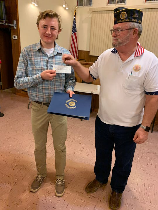 Mountain Home senior Shadd Darracq is presented a $1,000 check for Oratorical Committee Chair Frank Kaye for winning the Alley-White American Legion Post 52 High School Oratorical Contest.