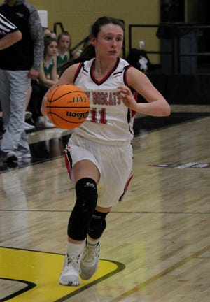 Flippin's Hope Rackley brings the ball upcourt during the Lady Bobcats' loss to Des Arc on Wednesday night.