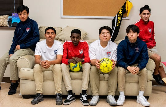 Park Crossing soccer players, from left, Kevin Tran, Gerardo Dominguez, Ryan Trim, Minwoo Kim, Seungwoo Hong and Mohammed Al-Azzani pose on the campus in Montgomery, Ala., on Thursday March 5, 2020.