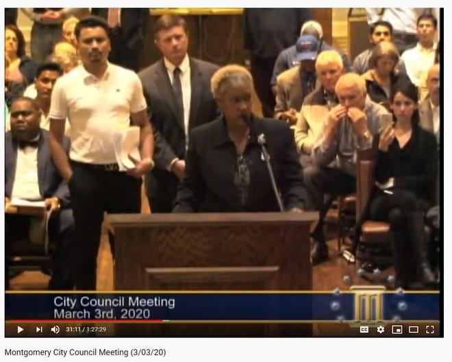 Screen shot of Karen Kramer of the Forest Park Neighborhood Association from March 3 City Council meeting. Yamal Bhagat stands behind Kramer.