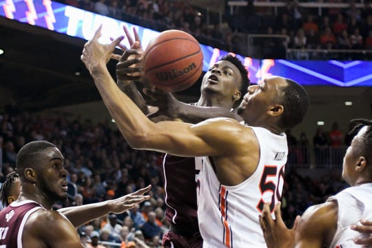 Texas A&M forward Emanuel Miller (5) and Auburn center Austin Wiley (50) grab for a rebound during the first half of an NCAA college basketball game Wednesday, March 4, 2020, in Auburn, Ala. (AP Photo/Julie Bennett)