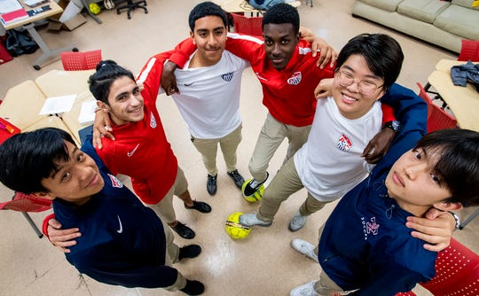 Park Crossing soccer players, from left,Kevin Tran, Mohammed Al-Azzani, Gerardo Dominguez, Ryan Trim, Minwoo Kim and Seungwoo Hong pose together on the campus in Montgomery, Ala., on Thursday March 5, 2020.