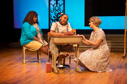 "Faith Gatson, left, and Camryn Dillard play older and younger versions of Ruby Bridges with Adrian Lee Borden as Ruby's teacher, Mrs. Barbara Henry, in ""Ruby: The Story of Ruby Bridges"" at Alabama Shakespeare Festival on March 6-22."