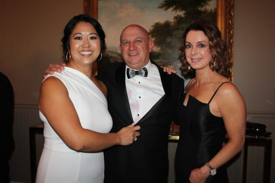 Dr. Libby Long Taylor, right, stands with Priscilla and Blake Smith at the 2019 Ugly Duckling Ball in Murfreesboro.