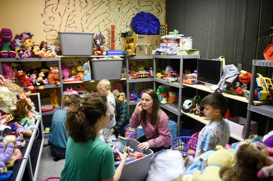 Volunteers sort through donations in the toy room of the Foster Closet in Cookeville on March 5.