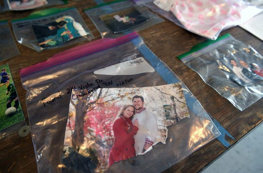 Table at the Cookeville Community Center holds photographs found after the tornado.  Photographs and other lost and found items were on display on Thursday, March 5, 2020.
