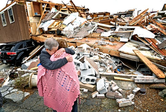 """Bill and Shirley Wallace tearfully hug as they return to the house where they were trapped when it fell on them during the tornado in Mt. Juliet on Wednesday, March 4, 2020. They escaped with the help of neighbors from the small hole in the rubble just to the right of where they are standing. """"There was a higher being than us with us the whole time,"""" Bill Wallace said."""