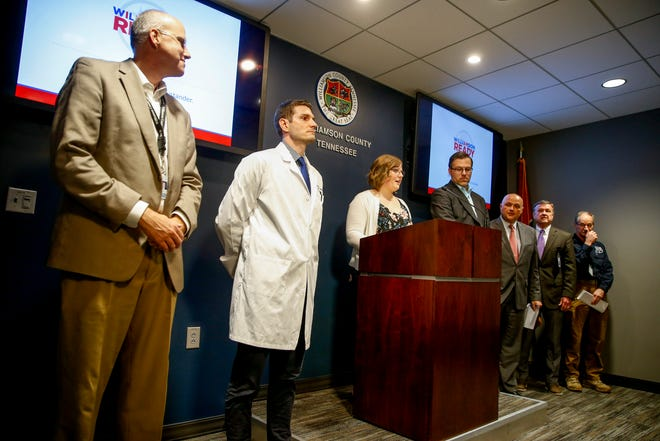 Public officials line up at the front of a briefing room in a press conference about the first confirmed coronavirus (COVID-19) case in Tennessee at the Williamson County Public Safety Center in Franklin, Tenn., on Thursday, March 5, 2020.