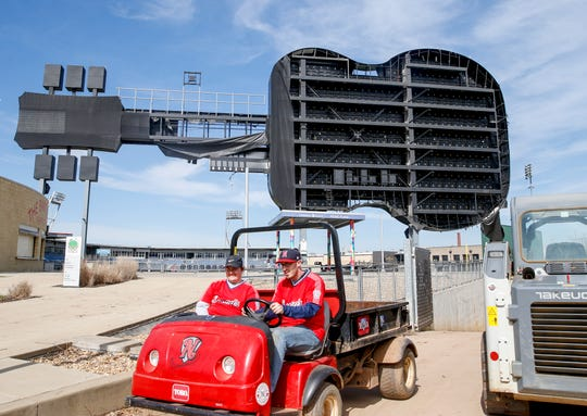 Nashville Sounds employees drive by in a cart in front of the Nashville Sounds guitar sign that suffered damage during a tornado from the early morning hours of March 3 as shown in this image taken at Sounds Stadium in Nashville, Tenn., on Thursday, March 5, 2020.