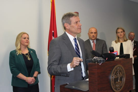 Gov. Bill Lee announces the first case of coronavirus on in Tennessee on Thursday while flanked by state health commissioner Lisa Piercey and state epidemiologist John Dunn.