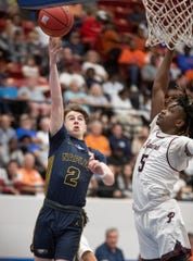 Naples' Max Youmans takes a shot against Pembroke Pines Charter in the Class 5A state semifinal game in Lakeland on Thursday. Pembroke Pines won 81-71.