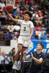 Geoffrey Sprouse hits a layup for Pembroke Pines Charter against Naples in the Class 5A state semifinal game in Lakeland on Thursday.
