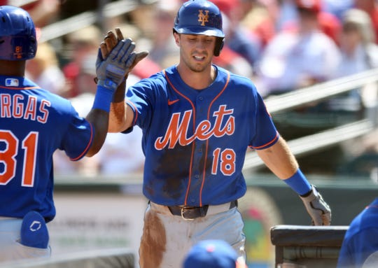 Mar 5, 2020; Jupiter, Florida, USA; New York Mets outfielder Ryan Cordell (18) is congratulated after scoring a run in the second inning by teammate Johneshwy Fargas (81) at Roger Dean Chevrolet Stadium.