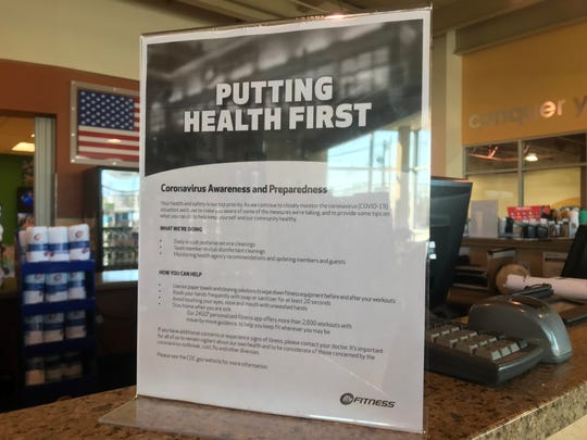 A tabletop flier provides tips on coronavirus preparedness at 24 Hour Fitness on Route 17 south in Hasbrouck Heights.