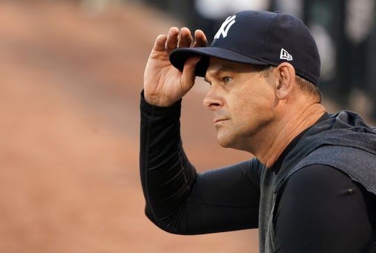 Mar 4, 2020; Tampa, Florida, USA; New York Yankees manager Aaron Boone looks out onto the field before the start of their game against the Philadelphia Phillies at George M. Steinbrenner Field.