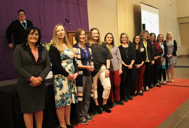 Las Cruces Public Schools Superintendent Karen Trujillo, left, stands with 10 semifinalists for the district's Teacher of the Year award.