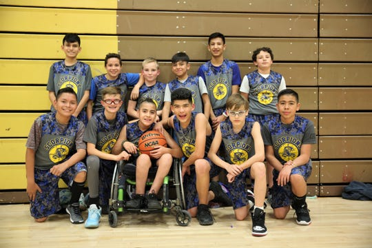 Picacho Middle School boys basketball team stand for a photo at the Picacho Middle School gym on Wednesday, March 5,  2020.