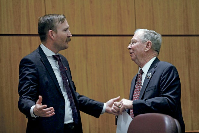 Sens. Cliff R. Pirtle, R-Roswell, left, and William H. Payne, R-Albuquerque, speak during the debate Friday on the Extreme Risk Protection Order Act. The bill passed 22-20 without any Republican support.