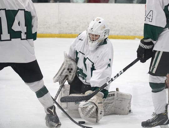 Novi goalie Austin Muirhead gathers up a shot on goal.