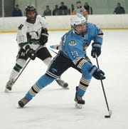 Trailed by Novi Wildcat Jay Naidu, Stevenson Spartan Nick Justice brings the puck into the Wildcat zone.