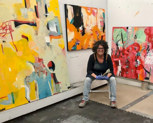 Artist Anne Bedrick poses in her studio In Cathedral City.
