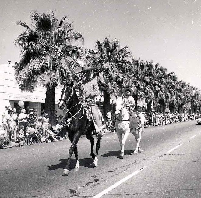 Palm Springs Mayor Frank Bogert and daughter Donna  ride in the Desert Circus parade in 1963.