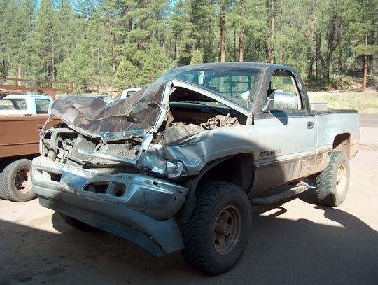 The aftermath of elk damage to a truck following a collision.