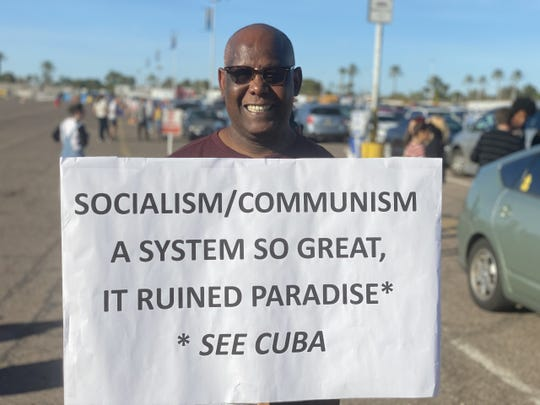 James Barber protests outside a Bernie Sanders rally on March 5, 2020.