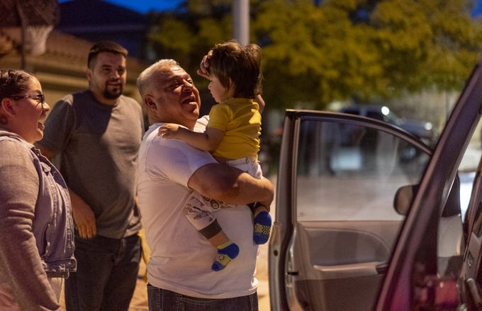 Joel Diaz Rincon, 51, is reunited with Marjorie Gutierrez, 28, his goddaughter and niece, her husband, Giovanny, 27, and their son, Leo, 1, in Mesa.