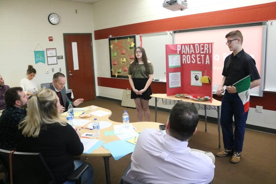 "Lily Lucero and Bryce Copeland, of Port Clinton Middle School, pitch their idea for a new local business, ""Panaderia Roseta,"" to the Shark Tank on Wednesday as part of the PCMS Young Entrepreneurs club."