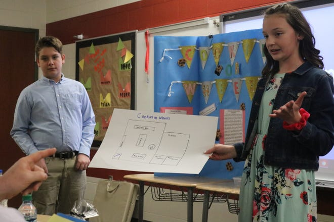 """Caden Hanson and Marissa Frohne, of Port Clinton Middle School, pitch their local business idea, """"Cookies on Wheels,"""" to the Shark Tank on Wednesday as part of the PCMS Young Entrepreneurs club."""