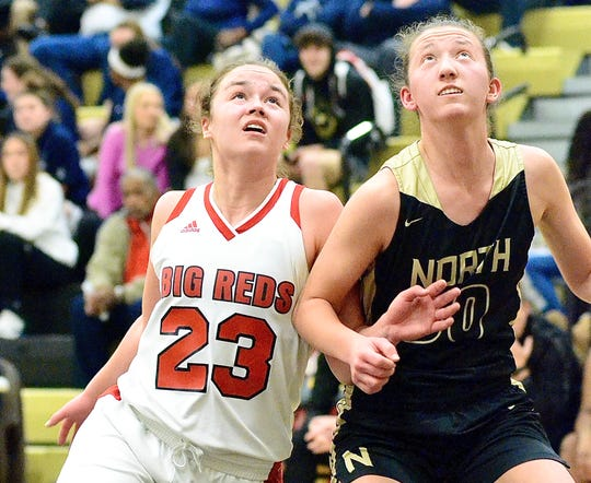 Port Huron's Morgan James looks for a rebound against host L'Anse Creuse North in a Division 1 girls basketball district semifinal game on Wednesday, March 4, 2020.