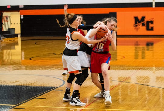 Players from Marine City try to steal the ball from St. Clair's Christina Bohm (10) during the MHSAA Division 2 district semifinal match Wednesday, March 4, 2020, at Marine City High School.