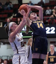 Lourdes' Ava Learn is pressured by Arlington's Devon Schmitt during their Class AA semifinal at the Westchester County Center Mar. 5, 2020. Lourdes won 66-54 in overtime.