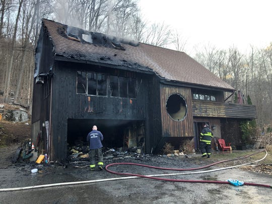 An early morning fire heavily damaged a two-story fire on Route 262 in Holmes as seen on Thursday, March 5, 2020.