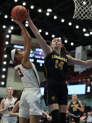 Lourdes' Ava Learn blocks a shot by Arlington's Mia Castillo during their Class AA semifinal at the Westchester County Center Mar. 5, 2020. Lourdes won 66-54 in overtime.