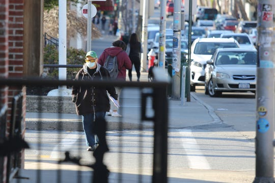 A man wearing a face mask on Main Street in the City of Beacon on March 5, 2020.