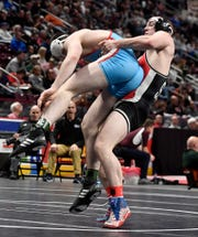 Colby Romjue of Susquehannock slams Matt Kidwell of Father Judge to the mat during the 160 pound preliminary round of the PIAA wrestling championship, 