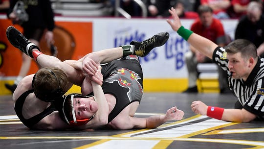 Dante Frinzi of Beth Catholic earns back points on Mason Leiphart of Dover in the 113 pound, first round match of the PIAA wrestling championship, Thursday, March 5, 2020.