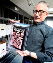 Hake's Auctions Production Manager Todd Sheffer holds the first Teenage Ninja Turtle comic in the auction room at the Springettsbury Township business Thursday, March 5, 2020. The company is hosting an online and phone bidding auction March 11 and 12. Bill Kalina photo