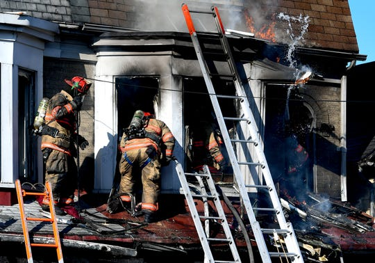 Firefighters battle a blaze in the 600 block of South Pershing Street in York City Thursday, March 5, 2020. Bill Kalina photo