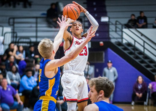 Richmond's Tytan Newton shoots past Greenfield-Central during their game at the Muncie Fieldhouse Wednesday, March 4, 2020.