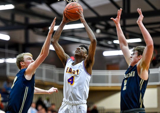 East's Zechariah Harris-Scott, center, drives to the basket against Pittsford Sutherland during a Class A2 sectional semifinal at Gates Chili High School, Wednesday, Mar. 4, 2020.