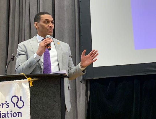 Carl V. Hill, the Alzheimer's Association's Vice President of Scientific Engagement, speaks at the ninth annual Dr. Lemuel and Gloria Rogers Health Symposium in Rochester Thursday. The event was attended by more than 250 local caregivers.